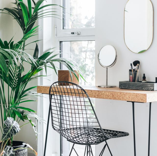 A corner of the modern, stylish and bright bedroom with plants