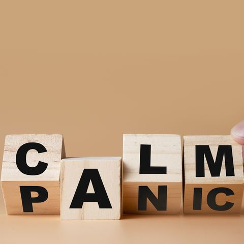 hand flipping wooden cubes for change wording panic   to  calm  mindset is important for human development