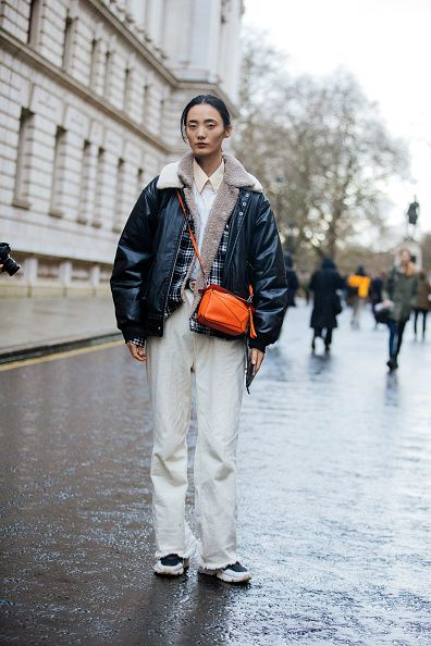 london, england   february 16 model liu huan wears a black jacket, orange loewe puzzle bag, white pants after the roksanda show during london fashion week february 2020 on february 16, 2020 in london, england photo by melodie jenggetty images