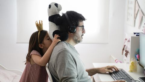 man doing telework and reconciling family life