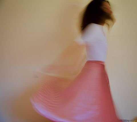 a girl dancing on her bed in the time of the corona virus