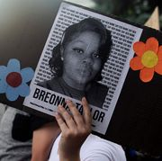 a demonstrator holds a sign with the image of breonna taylor, a black woman who was fatally shot by louisville metro police department officers, during a protest against the death george floyd in minneapolis, in denver, colorado on june 3, 2020   us protesters welcomed new charges brought wednesday against minneapolis officers in the killing of african american man george floyd    but thousands still marched in cities across the country for a ninth straight night, chanting against racism and police brutality photo by jason connolly  afp photo by jason connollyafp via getty images