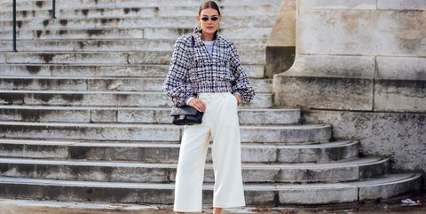 paris, france   march 03  modelstylist vera van erp attends the chanel show in earrings, a black and white tweed jacket, chanel sweater, gold bracelet, black quilted chanel bag, white culotte pants, and black and white heels during paris fashion week fallwinter 2020 on march 03, 2020 in paris, france photo by melodie jenggetty images