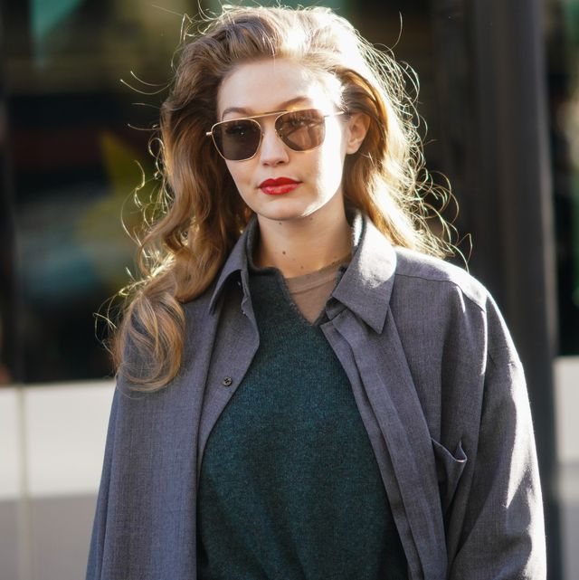 paris, france   february 26 gigi hadid wears sunglasses, a gray jacket, a green wool pullover, outside lanvin, during paris fashion week   womenswear fallwinter 20202021, on february 26, 2020 in paris, france photo by edward berthelotgetty images