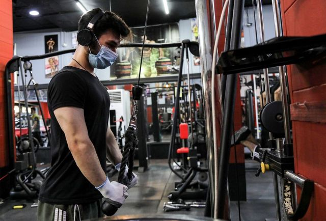a man clad in mask due to the covid 19 coronavirus pandemic exercises at a gym in arbil, the capital of the northern iraqi kurdish autonomous region, on june 13, 2020 photo by safin hamed  afp photo by safin hamedafp via getty images