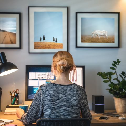 woman working on computer in her home office during pandemic quarantine