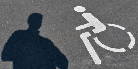 17 june 2020, brandenburg, ludwigsfelde a pictogram for a disabled parking space and a shadow of a person can be seen on the asphalt photo patrick pleuldpa zentralbildzb photo by patrick pleulpicture alliance via getty images