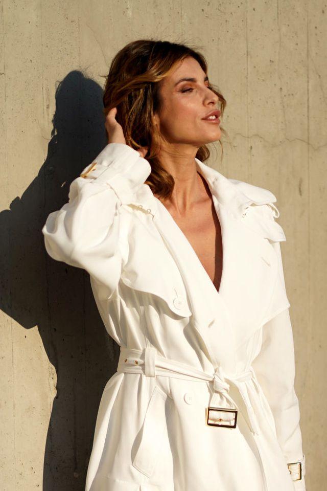 milan, italy   february 19 elisabetta canalis wears earrings, a white jacket, outside alberta ferretti, during milan fashion week fallwinter 2020 2021, on february 19, 2020 in milan, italy photo by edward berthelotgetty images