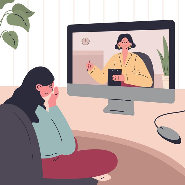 young woman in a session with a psychologist online at home
