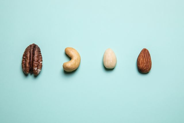 flat lay mixed nuts against blue background