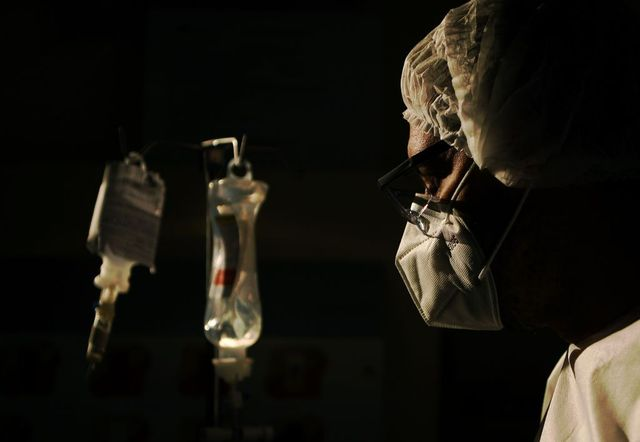 a surgeon checks the intravenous drip of one of his covid 19 patients, at the oceanico hospital in niteroi, rio de janeiro on june 22, 2020, during the coronavirus pandemic photo by carl de souza  afp photo by carl de souzaafp via getty images