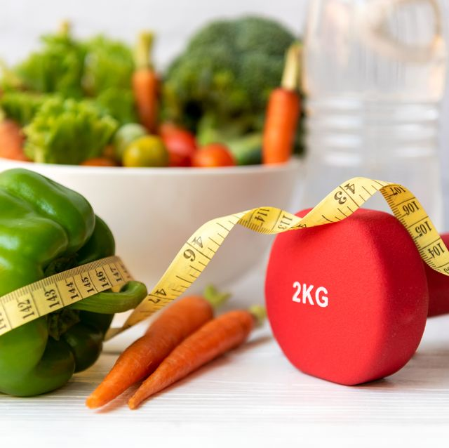 diet health food and lifestyle health concept sport exercise equipment workoutandgym background with fresh salad and measuring tap for fitness style stay at home healthy lifestyle concept