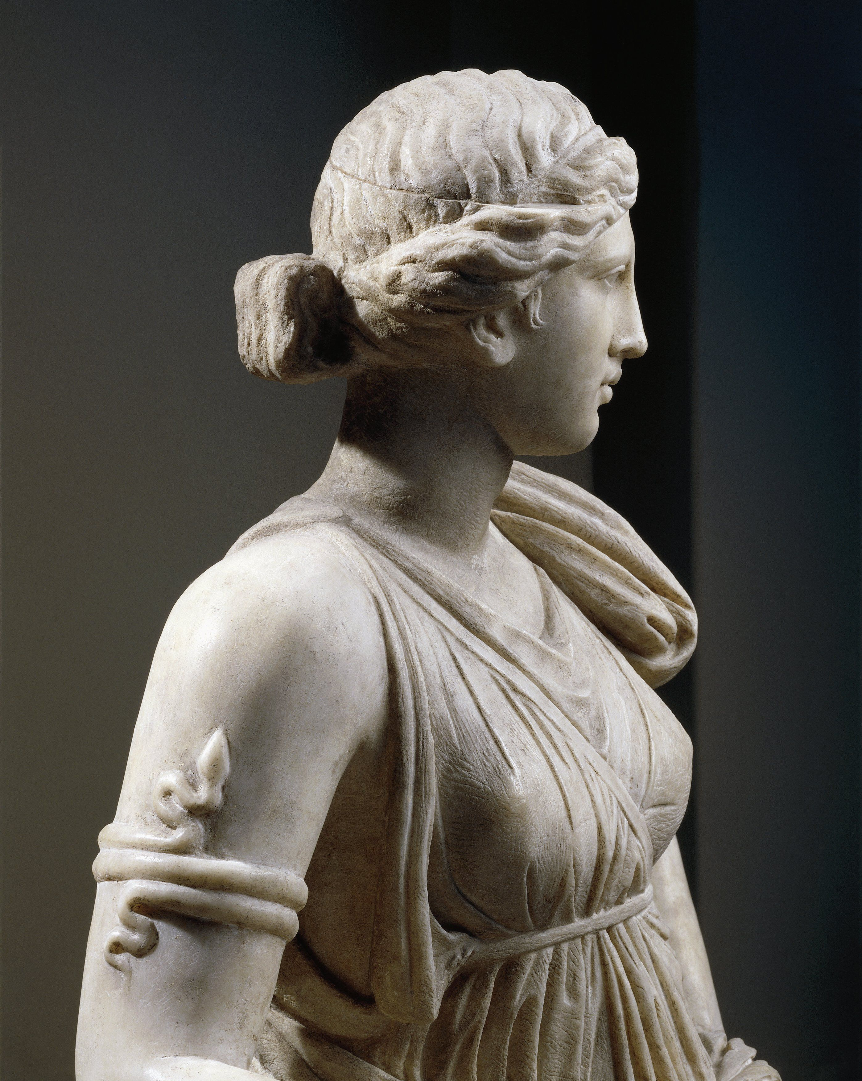 Marble statue of Artemis, copy of Greek original of 4th century b.c., detail of bust, arm with snake-shaped bracelet, from Mytilene, Island of Lesbos, Greece