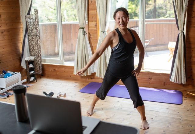 one woman exercising while staying at home