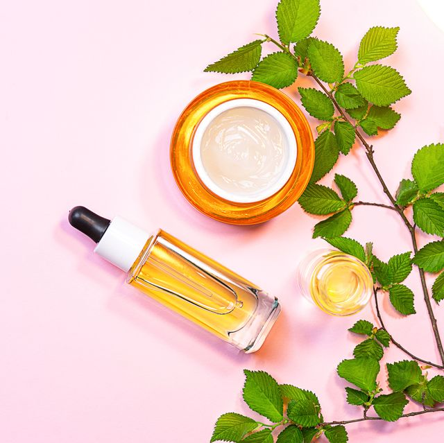 skin care beauty products, natural cosmetic flat lay image on pink background natural cosmetic skincare bottle, serum and organic green leaf homemade and beauty product concept