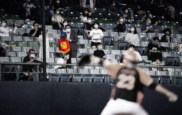 new taipei city, taiwan   may 08 fans waving flag signs during the cpbl game between fubon guardians and uni lions at the xinzhuang baseball stadium on may 08, 2020 in new taipei city, taiwan the cpbl lets 1000 fans in the stadium for the first time after the new season started behind closed doors photo by gene wanggetty images