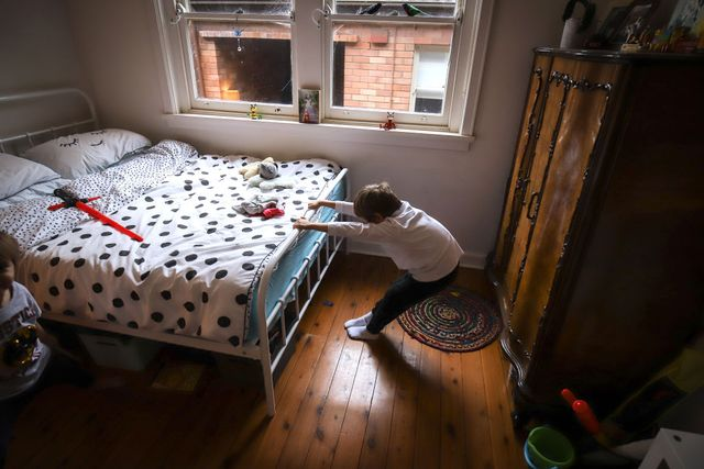 sydney, australia   may 25 six year old kaya atayman stretches as he prepares for school on may 25, 2020 in sydney, australia students in new south wales return to regular lessons today, after a week of staggered lessons, as covid 19 restrictions ease across australia   photo by david graygetty images