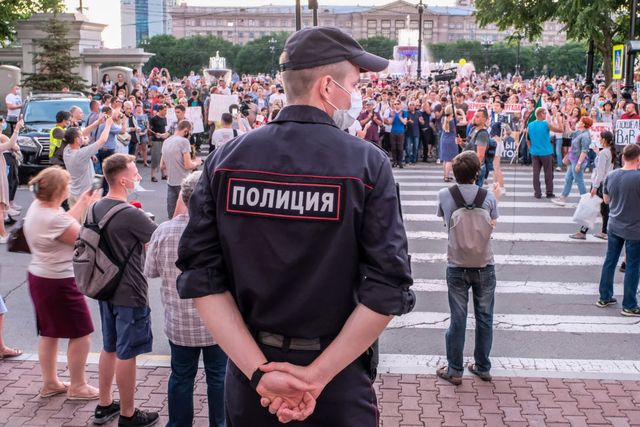 khabarovsk, russia   july 21, 2020 a police officer guards an area during a mass rally against newly appointed khabarovsk territory acting governor mikhail degtyarev protesters support khabarovsk territory governor sergei furgal, who was detained on 9 july 2020 and charged with masterminding murders of two local businessmen and a murder attempt on another back in 2004 2005 dmitry morgulistass photo by dmitry morgulis\tass via getty images