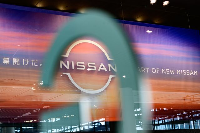 the nissan logo is pictured though the glass of a showroom at nissans global headquarters in yokohama on july 28, 2020   the japanese auto maker was expected to announce the companys first quarter earnings results later in the day photo by philip fong  afp photo by philip fongafp via getty images