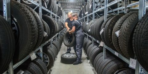 31 july 2020, saxony anhalt, eilsleben rico skiebe l, fourth year apprentice automotive mechatronics technician and his brother justin skiebe lifting tyres off the shelves in the tyre warehouse of the eilsleben car dealership justin skiebe will start an apprenticeship as a car mechatronics technician there on 01 august 2020 in the magdeburg district of the chamber of crafts, a good 820 apprentices will start training in the craft on august 1 that is a good ten percent less than a year ago, the chamber of trade announced photo klaus dietmar gabbertdpa zentralbilddpa photo by klaus dietmar gabbertpicture alliance via getty images