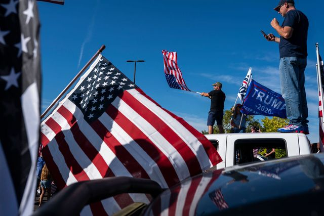 portland, or   august 29 trump supporters wave flags while standing on the roofs of their cars during a rally in support of the president on august 29, 2020 in clackamas, oregon far left counter protesters and pro trump supporters clashed saturday afternoon as a parade of cars carrying right wing supporters made their way from nearby clackamas to portland  photo by nathan howardgetty images
