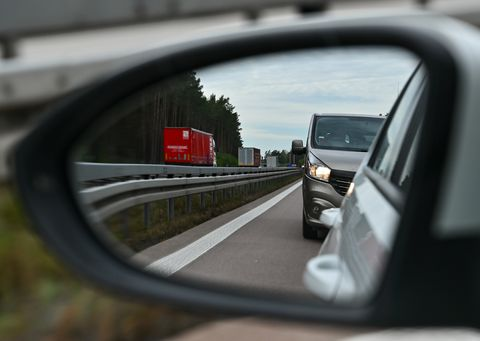 05 october 2020, brandenburg, fürstenwalde much too close up is a van, which can be seen in the outside mirror of a car, in the left lane of a motorway photo patrick pleuldpa zentralbildzb photo by patrick pleulpicture alliance via getty images