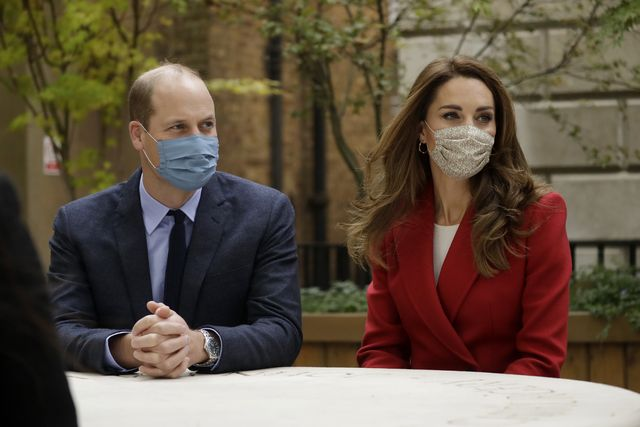 london, england   october 20 prince william and catherine, duchess of cambridge meet pharmacist joyce duah as they visit st bartholomews hospital in london, to mark the launch of the nationwide hold still community photography project, on october 20th, 2020 in london, england  the duke and duchess of cambridge on tuesday met a small number of staff from the hospital, including pharmacist and photographer joyce duah and the two pharmacy technician colleagues she photographed writing on their ppe as they put it on, in a photograph that was selected to be in the set of 100 images taken during the coronavirus lockdown photo by matt dunham   wpa poolgetty images