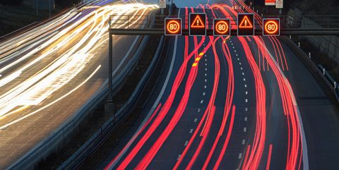 30 december 2020, saxony, dresden the headlights of passing vehicles draw 4 light trails on the highway in the morning shot with long exposure photo robert michaeldpa zentralbilddpa photo by robert michaelpicture alliance via getty images