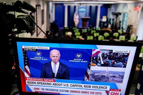 washington, dc   january 06 president elect joe biden is shown speaking on a monitor in the white house briefing room about the violence during the ratification of the 2020 election on january 6, 2021 in washington, dc a pro trump mob entered the us capitol building after mass demonstrations in the nations capital photo by joshua robertsgetty images
