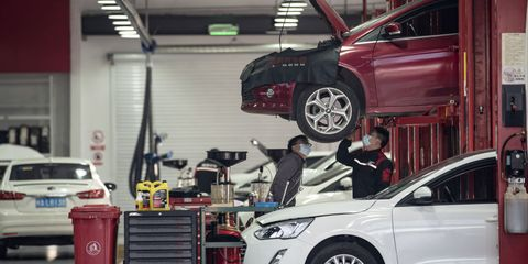 an employee inspects a vehicle at a tuhu repair and service center in shanghai, china, on wednesday, feb 3, 2021 the company is valued at $4 billion and is a major distributor of auto parts and chinas biggest internet based car maintenance service provider, according to founder chen min photographer qilai shenbloomberg via getty images