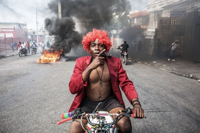 topshot   demonstrators march in port au prince on february 14, 2021, to protest against the government of president jovenel moise   several thousand people demonstrated sunday in the haitian capital port au prince, saying the government was trying to establish a new dictatorship and denouncing international support for president jovenel moise the protests were mostly peaceful, although a few clashes broke out between some demonstrators and police, who fired tear gas and rubber bullets photo by valerie baeriswyl  afp photo by valerie baeriswylafp via getty images