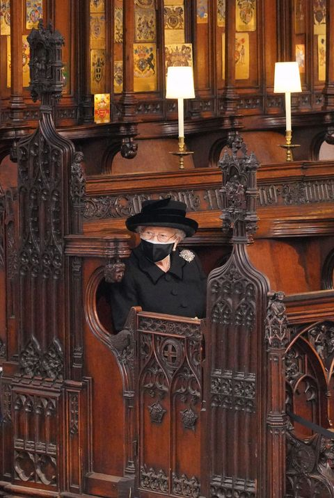 queen elizabeth ii takes her seat for the funeral service of britains prince philip, duke of edinburgh inside st georges chapel in windsor castle in windsor, west of london, on april 17, 2021   philip, who was married to queen elizabeth ii for 73 years, died on april 9 aged 99 just weeks after a month long stay in hospital for treatment to a heart condition and an infection photo by jonathan brady  pool  afp photo by jonathan bradypoolafp via getty images