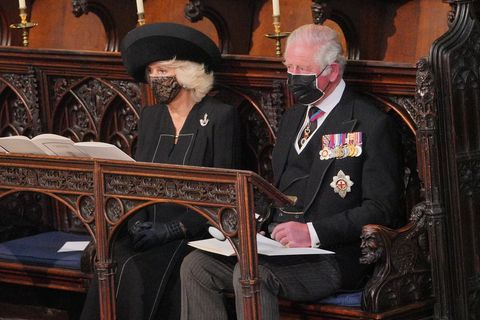 britains camilla, duchess of cornwall and britains prince charles, prince of wales sit during the funeral service of britains prince philip, duke of edinburgh inside st georges chapel in windsor castle in windsor, west of london, on april 17, 2021   philip, who was married to queen elizabeth ii for 73 years, died on april 9 aged 99 just weeks after a month long stay in hospital for treatment to a heart condition and an infection photo by dominic lipinski  pool  afp photo by dominic lipinskipoolafp via getty images