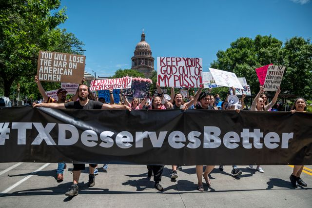 austin, tx   may 29 pro choice protesters march down congress avenue at a protest outside the texas state capitol on may 29, 2021 in austin, texas thousands of protesters came out in response to a new bill outlawing abortions after a fetal heartbeat is detected signed on wednesday by texas governor greg abbot photo by sergio floresgetty images