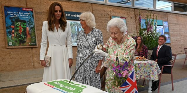 st austell, england   june 11 queen elizabeth ii c attempts to cut a cake with a sword, lent to her by the lord lieutenant of cornwall, edward bolitho, to celebrate of the big lunch initiative at the eden project during the g7 summit on june 11, 2021 in st austell, cornwall, england uk prime minister, boris johnson, hosts leaders from the usa, japan, germany, france, italy and canada at the g7 summit this year the uk has invited india, south africa, and south korea to attend the leaders' summit as guest countries as well as the eu photo by oli scarff   wpa pool  getty images