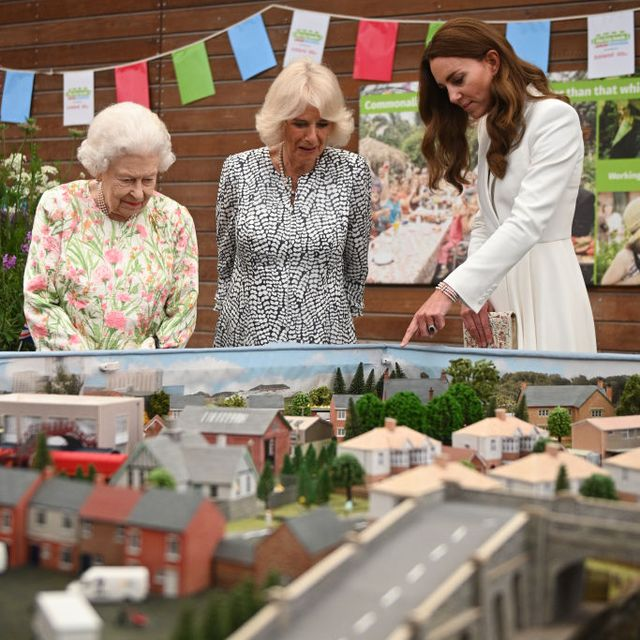 st austell, england   june 11 queen elizabeth ii l, camilla, duchess of cornwall c and catherine, duchess of cambridge r look at a scale model of big lunch events that have been held over the years during an event in celebration of the big lunch initiative at the eden project during the g7 summit on june 11, 2021 in st austell, cornwall, england uk prime minister, boris johnson, hosts leaders from the usa, japan, germany, france, italy and canada at the g7 summit this year the uk has invited india, south africa, and south korea to attend the leaders' summit as guest countries as well as the eu photo by oli scarff   wpa pool  getty images
