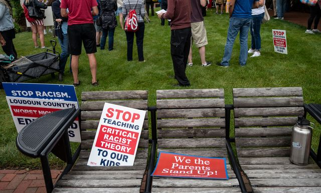 signs are seen on a bench during a rally against critical race theory crt being taught in schools at the loudoun county government center in leesburg, virginia on june 12, 2021   are you ready to take back our schools republican activist patti menders shouted at a rally opposing anti racism teaching that critics like her say trains white children to see themselves as oppressors yes, answered in unison the hundreds of demonstrators gathered this weekend near washington to fight against critical race theory, the latest battleground of americas ongoing culture wars the term critical race theory defines a strand of thought that appeared in american law schools in the late 1970s and which looks at racism as a system, enabled by laws and institutions, rather than at the level of individual prejudices but critics use it as a catch all phrase that attacks teachers efforts to confront dark episodes in american history, including slavery and segregation, as well as to tackle racist stereotypes photo by andrew caballero reynolds  afp photo by andrew caballero reynoldsafp via getty images