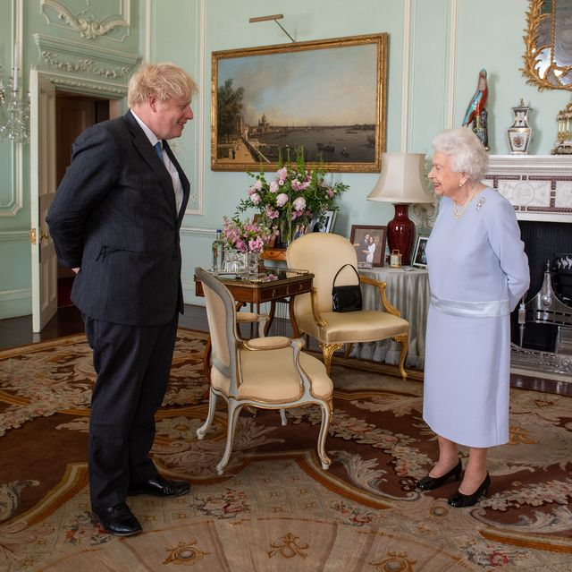 london, england   june 23 queen elizabeth ii greets prime minister boris johnson during the first in person weekly audience with the prime minister since the start of the coronavirus pandemic at buckingham palace on june 23, 2021 in london, england photo by dominic lipinski   wpa poolgetty images