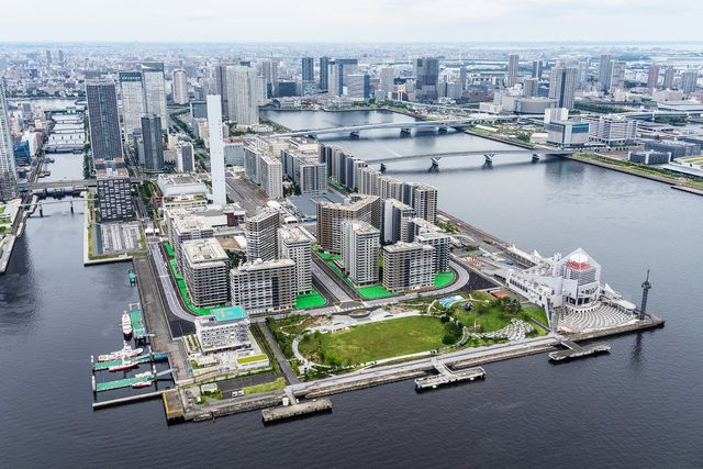 the tokyo olympic village is pictured from a helicopter in june 2021