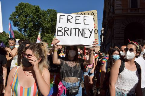 rome, italy   june 26 people with a sign saying free britney, referring to britney spears take part in rome pride, the lgbtqia parade, on june 26, 2021 in rome, italy the italian prime minister defended parliament after the vatican requested a revision on an anti discrimination draft bill that provides protection for lgbtq persons, saying the new law could interfere with religious freedoms photo by simona granati   corbiscorbis via getty images