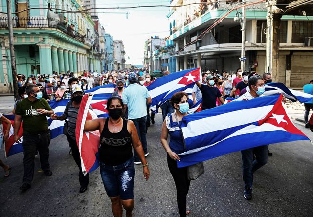 """people take part in a demonstration to support the government of the cuban president miguel diaz canel in havana, on july 11, 2021   thousands of cubans took part in rare protests sunday against the communist government, marching through a town chanting """"down with the dictatorship"""" and """"we want liberty"""" photo by yamil lage  afp photo by yamil lageafp via getty images"""