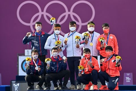 silver medallists taiwans deng yu cheng lower l, tang chih chun lower 2nd l and wei chun heng top l, gold medallists south koreas kim je deok top 2nd l, kim woo jin top c and oh jin hyek top 2nd r, bronze medallists japans takaharu furukawa top r, japans yuki kawata lower 2nd r and hiroki muto lower r pose on the podium during the mens team victory ceremony during the tokyo 2020 olympic games at yumenoshima park archery field in tokyo on july 26, 2021 photo by adek berry  afp photo by adek berryafp via getty images