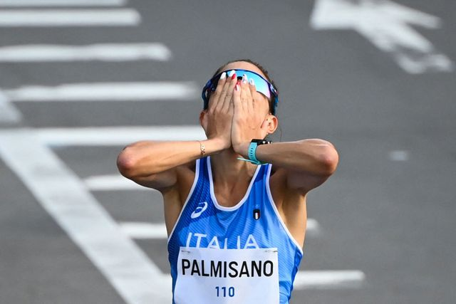italys antonella palmisano celebrates after crossing the finish line to win the womens 20km race walk final during the tokyo 2020 olympic games at the sapporo odori park in sapporo on august 6, 2021 photo by charly triballeau  afp photo by charly triballeauafp via getty images