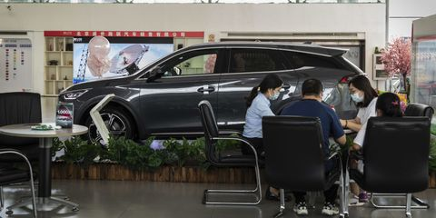customers inside a byd co showroom in beijing, china, on wednesday, aug 25, 2021 byd reports its quarterly earnings figures on aug 27 photographer qilai shenbloomberg via getty images