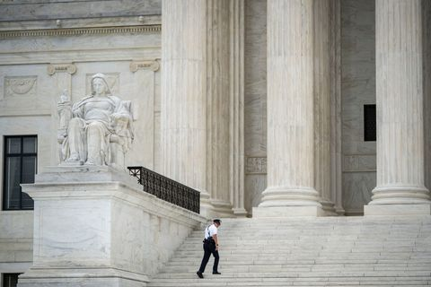 washington, dc   september 01 a supreme court police officer walks on the steps of the us supreme court on september 1, 2021 in washington, dc a new texas law that prohibits most abortions after six weeks of pregnancy went into effect on wednesday the us supreme court did not act on a request to block the law photo by drew angerergetty images
