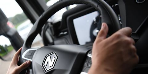 a test driver at the steering wheel of a nikola tre battery electric heavy duty truck at the nikola corp iveco spa joint venture electric truck plant in ulm, germany, on wednesday, sept 15, 2021 nikola iveco europe gmbh hosted an eventwhere its partner iveco    the commercial vehicle unit ofcnh industrial nv   is preparing to start series production of nikola tre heavy duty trucks by year endphotographer andreas gebertbloomberg via getty images