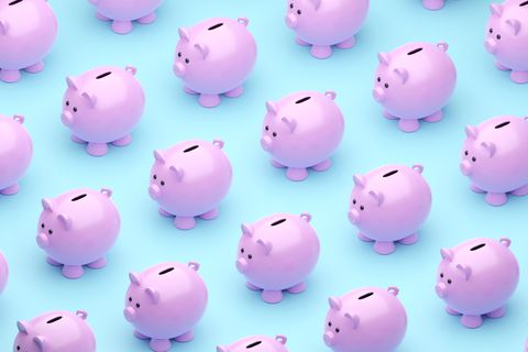 orthographic perspective of digitally generated piggy banks on a blue background