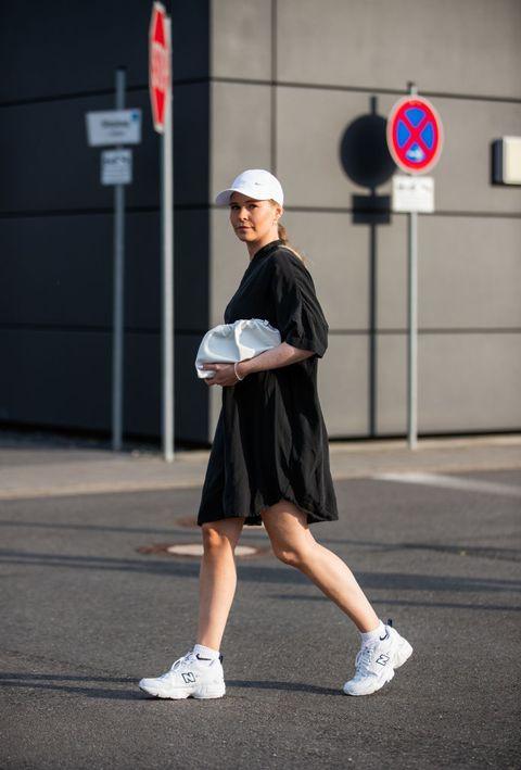 dusseldorf, germany   june 12 inga brauer is seen wearing black blouse dress other stories, new balance 609 sneaker, white socks nike, cap nike, white clutch asos on june 12, 2020 in dusseldorf, germany photo by christian vieriggetty images