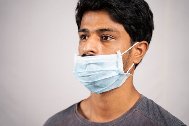 man wearing mask over mouth but not nose