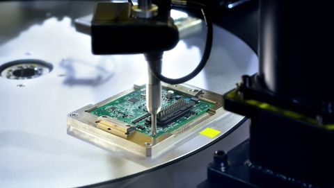 close up of making circuit board at production line